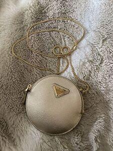 prada gold coin purse w/ chain