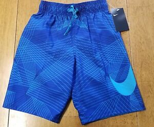 NWT NIKE Blue Swoosh Geometric Pattern SWIM TRUNKS BOARD SHORTS Boy SMALL 8-9 yr