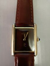 Ladies Cartier Silver 925 stamped gilded rectangular strap watch.