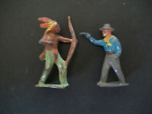 BRITAINS 54MM HOLLOW CAST COWBOY AND UNKNOWN INDIAN