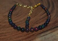 Ethiopian Welo Fire Black Opal Smooth Chips Uncut heishi Beads Strand Gift for her 6 Inch Bracelet Charming Super Top Quality