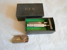 vintage safety razor PJA Cheese wedge type single blade and sharpener