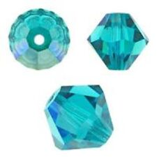 Swarovski Crystal Bicone. Blue Zircon Color AB . 6mm. Approx. 48 PCS. 5328