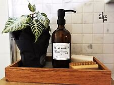 Amber glass bottle soap dispenser with metal pump and designer label decal