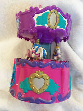 LOT # 1011 SQUINKIES CAROUSEL moving DISPENSER (2012) (Blip Toys) 7 1/2 inches.