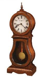 635-162  CLEO  HOWARD MILLER   MANTEL CLOCK  IN CHESTNUT FINISH