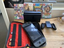 Nintendo Switch with 4 games, Switch Joy Con   Case