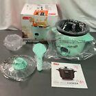 Dash DRCM200 Mint Non Sticky One Touch Cooking 200 Watts Mini Rice Cooker photo