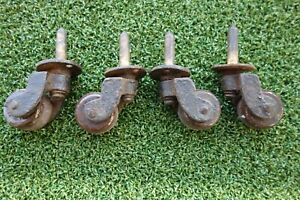 4 X ANTIQUE CERAMIC WHEEL CASTERS 1 INCH IN DIA X 1/2 INCH IN THICKNESS