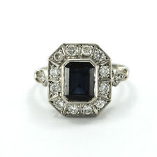 PLATINUM RING WITH BLUE SAPPHIRE AND DIAMONDS.