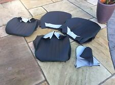 frogeye sprite seat covers black , green piping inc hinge covers