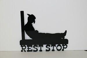 Plasma cut metal sign of cowboy rest stop