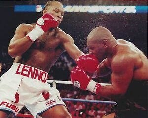 LENNOX LEWIS vs MIKE TYSON 8X10 PHOTO BOXING PICTURE LEFT BY LEWIS