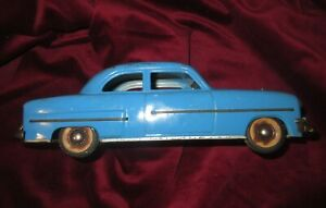 UNIQUE VINTAGE TIN WIND UP BLUE PONTIAC DELUX CAR MADE IN GERMANY