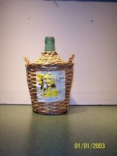 Wine bottle from Spain, basket woven, green, 1 gallon, 1969, with label