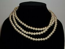 Plastic pearl beaded necklace, that would be great costume necklace.