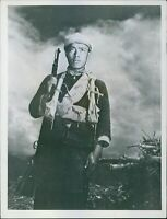 A close up portrait of a Chinese guerrilla fully quipped with weapon. - 8x10 pho