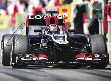 Kimi Raikkonen Hand Signed Lotus 16x12 Photo F1.