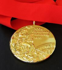 GOLD MEDAL - 1976 MONTREAL SUMMER OLYMPICS - WITH SILK RIBBON & STORAGE POUCH