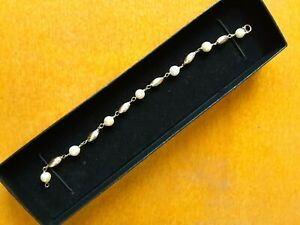 14K GOLD BEADS AND 7 PEARLS BRACELET