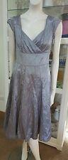 NWTS David Lawrence silver cocktail dress.Sz8.No iron finnish.Silk trim.Ret $299