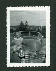 Cute Girl on Hood of 1941 Oldsmobile Convertible Car Vintage Photo 473187