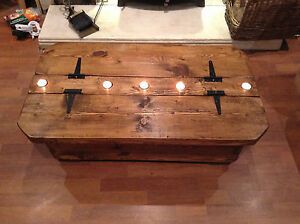 Le Morbihan a rustic storage coffee table incorporating 5 tea light recesses