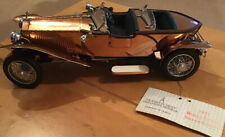 1921  Rolls Royce Silver Ghost copper covered body by Franklin Mint.
