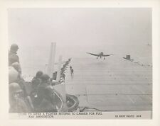 1940s WWII US Navy Photo carrier, Fighter airplane returns for Fuel & Ammo