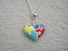 Stunning Autism Awareness Jigsaw Style 2 Necklace.With Organza Bag