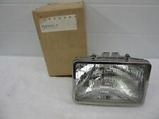 NOS 1976-1989 Buick Chevy Olds Caddy  LH Front Headlight Capsule GM 5973929 dp