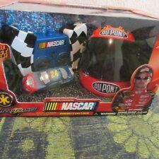 NIB~ NASCAR JEFF GORDEN RADIO CAR W/ HELMET CHARGER. 1:64 SCALE, DU PONT, # 24