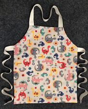 TODDLER'S CRAFT/COOKERY APRON MACHINE WASHABLE LINED. CUTE DINOSAURS DESIGN