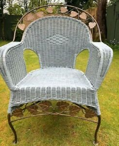 WICKER CHAIR WITH METAL DETAIL.