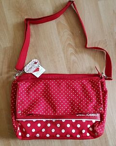 RED AND WHITE SPOTTED  BAG  - FOLDS OUT TO BE A TOTE BAG