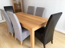 Solid oak dining table and 6 chairs in excellent condition