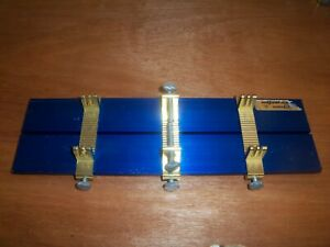 NICE RUSSKIT ADJUST-O-JIG CHASSIS BUILDING FIXTURE 1/24 1/32 ETC. + INSTRUCTIONS