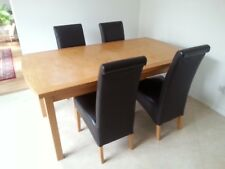Oak extending dining table and four chairs used
