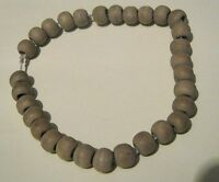 Very pretty elasticated bracelet with wooden beads