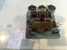 Transformer 1550A24G02 on metal plate with 3 Capacitor and resisitors
