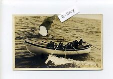 U.S. Navy RPPC real photo USS Nevada? sailors rowing in small boat, antique card