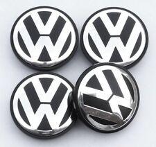 4 x 70 mm Volkswagen VW lega ruota centro COPRIMOZZI GOLF PASSAT POLO NERO