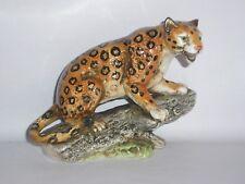 Continental figurine of a Leopard on Fallen Tree Branch .