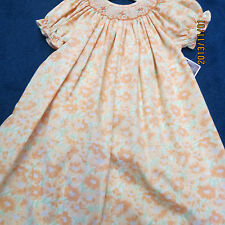 Will'beth Bishops dress size 24mo,pale oranges, w/greens. new w/tags smocking
