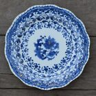 An antique chinese blue and white dish with molded rim period of Qianlong