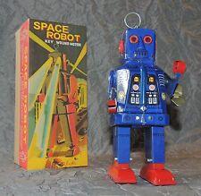 Jouet de l'Espace. Robot de l'espace bleu pieds rouges. Hauteur 20 cm. NEUF