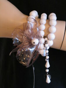 Furla triple beaded bracelet with quirky orchid trim attatched