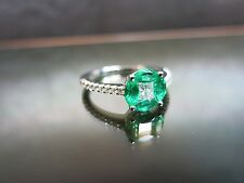 BELLA 18ct oro smeraldo e diamanti anello di Cluster
