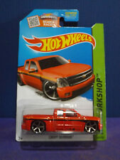 2014 Hot Wheels CHEVY SILVERADO in Red. HW WORKSHOP Long Card.