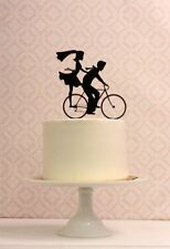 Our beautiful silhouette Bride & Groom riding bike wedding cake topper